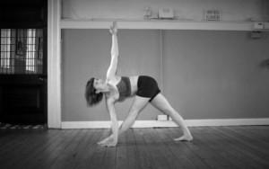 Rachel Woolhouse doing Trikonasa yoga pose