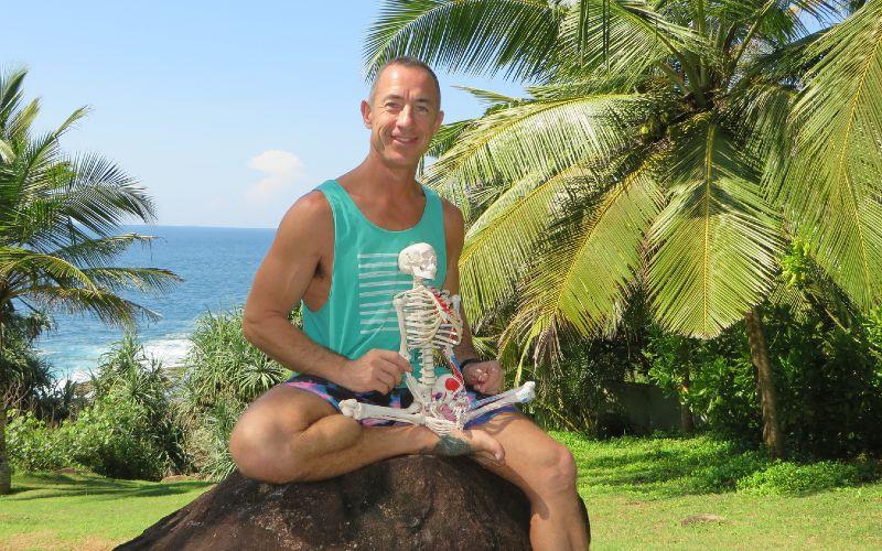 Stu Girling holding a model skeleton